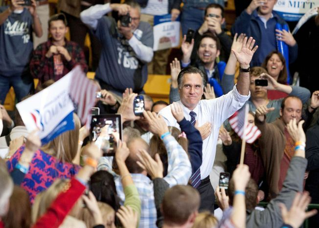 Former Massachusetts Gov. Mitt Romney, the Republican presidential nominee, waves goodbye to backers at a rally at the Patriot Center at George Mason University in Fairfax on Monday as he tries to wrest a few more last-minute votes in the swing state. (Craig Bisacre/The Washington Times)