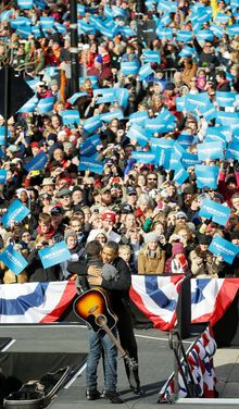 President Obama and singer Bruce Springsteen show unity on the stump during a campaign event near the state Capitol building in Madison, Wis., on Monday. (Associated Press)