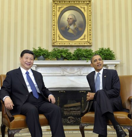 ** FILE ** Then-Chinese Vice President Xi Jinping (left) meets on Feb. 14, 2012, with President Obama in the Oval Office of the White House in Washington. (Associated Press)
