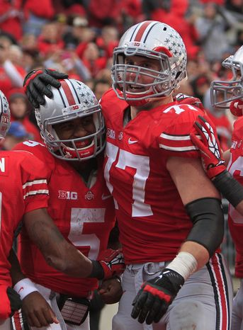 Ohio State quarterback Braxton Miller (left) celebrates his touchdown against Illinois with teammate Reid Fragel during the third quarter of Ohio State's 52-22 win over Illinois on Nov. 3, 2012, in Columbus, Ohio. (Associated Press)