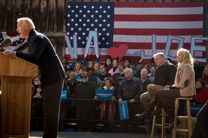 Dr. Jill Biden, right, and Virginia Democratic candidate for Senate Tim Kaine, second from right, sit on stage and listen as Vice President Joe Biden, left, speaks at a campaign rally at the Heritage Farm Museum at Claude Moore Park, Sterling, Va., Monday, November 5, 2012. (Andrew Harnik/The Washington Times)