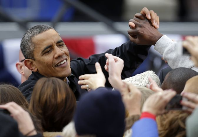 President Obama greets supporters after speaking at a campaign event near the Capitol in Madison, Wis., on Mon