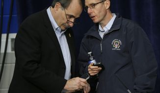 David Axelrod (left), senior adviser for the Obama campaign, and David Plouffe, White House senior adviser, talk during a campaign event for President Obama on Nov. 2, 2012, at Springfield High School in Springfield, Ohio. (Associated Press)