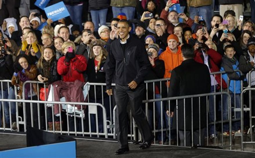 President Obama walks on stage after being introduced by first lady Michelle Obama (not shown) during his final 2012 campaign event in downtown Des Moines, Iowa, Monday, Nov. 5, 2012. (AP Photo/Pablo Martinez Monsivais)