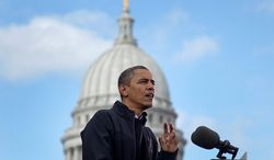 With the Wisconsin Capitol dome behind him, President Obama speaks at a campaign event on Monday, Nov. 5, 2012, in downtown Madison, Wis. (AP Photo/Carolyn Kaster)