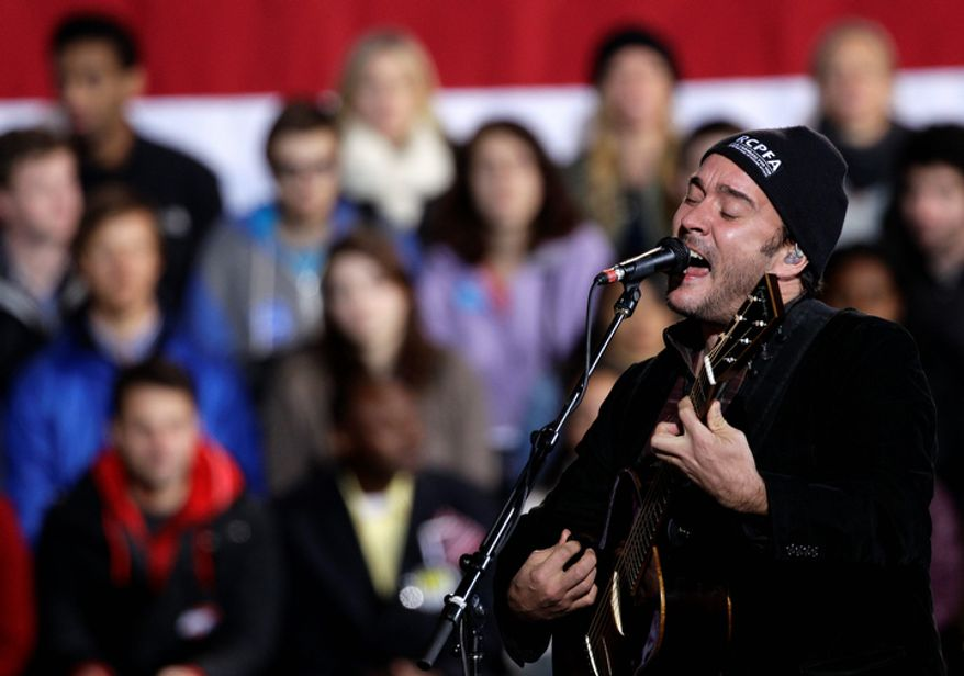 Musician Dave Matthews performs Nov. 4, 2012, before the arrival of President Obama for a campaign rally at the Community College of Aurora, in Aurora, Colo. (Associated Press)