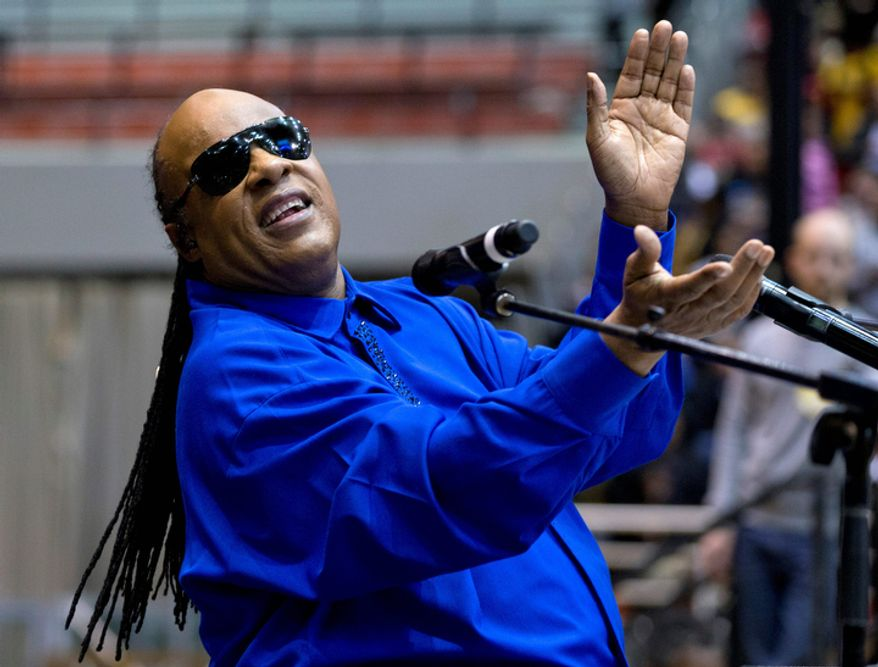 ** FILE ** Singer Stevie Wonder performs Nov. 4, 2012, at the Fifth Third Arena on the University of Cincinnati campus in Cincinnati before President Obama speaks at a campaign event. (Associated Press)