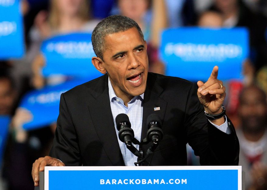 President Obama speaks at a campaign event at Nationwide Arena on Monday, Nov. 5, 2012, in Columbus, Ohio. (AP Photo/Tony Dejak)