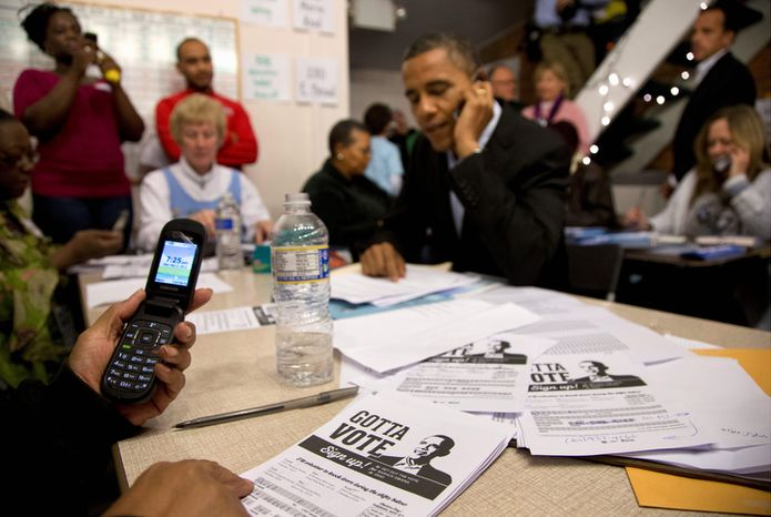 President Barack Obama makes a call as he visits a campaign office, Monday, Nov. 5, 2012, in the German Village section of Columbus, Ohio, to greet and make phone calls to volunteers.  (AP Photo/Carolyn Kaster)