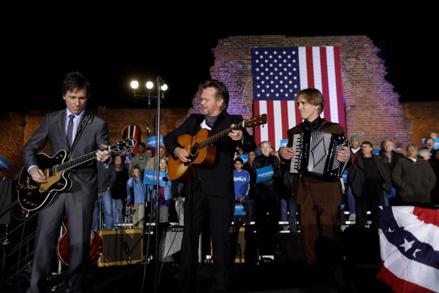 John Mellencamp, center, performs before Vice President Joe Biden speaks during a campaign rally at the American Civil War Center at the Historic Tredegar Ironworks Monday, Nov. 5, 2012, in Richmond, Va. (AP Photo/Matt Rourke)