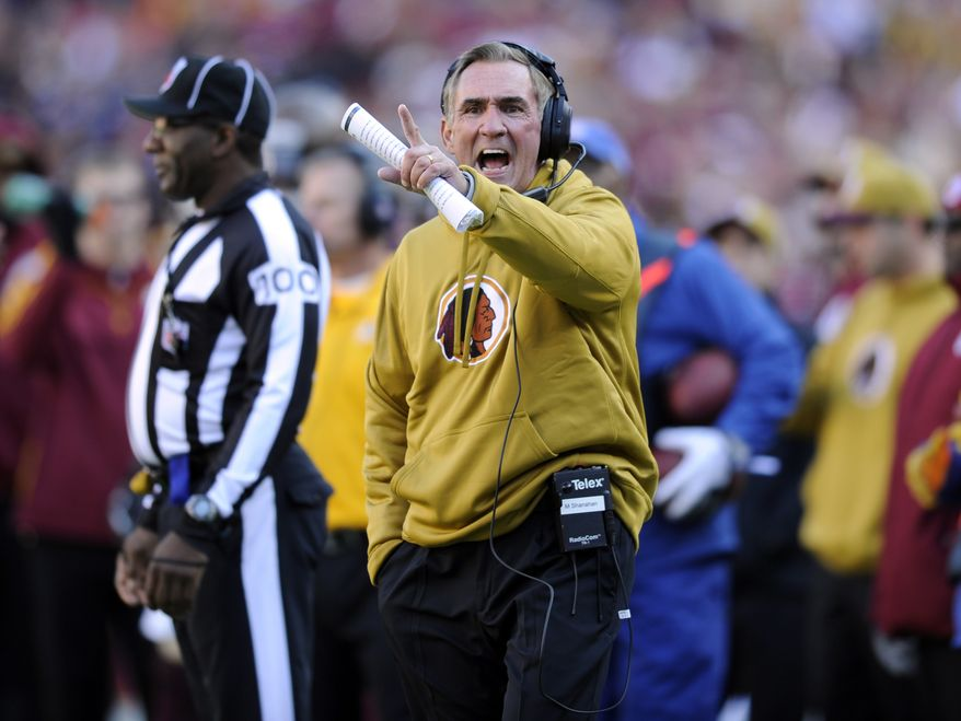 Washington Redskins head coach Mike Shanahan yells on the sidelines during the first half of an NFL football game against the Carolina Panthers Sunday, Nov. 4, 2012, in Landover, Md. (AP Photo/Nick Wass)