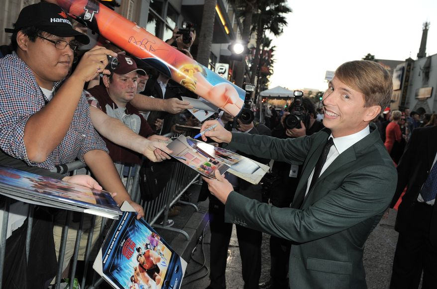 """Actor Jack McBrayer arrives at the world premiere of """"Wreck-It Ralph"""" at the El Capitan Theatre in Los Angeles on Monday, Oct. 29, 2012. Mr. McBrayer voices the character Fix-It Felix in the film. (Jordan Strauss/Invision/AP)"""