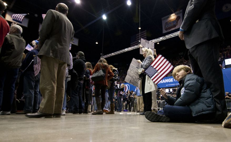A child sits on the floor during republican presidential candidate, former Massachusetts Gov. Mitt Romney campaign rally at The Patriot Center, George Mason University in Fairfax, Va., Monday, Nov. 5, 2012. (Craig Bisacre/The Washington Times)