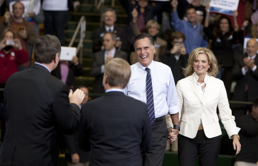 Republican presidential candidate, former Massachusetts Gov. Mitt Romney, accompanied by wife Ann, are greeted by Virginia Republican Senate candidate George Allen and Governor of Virginia, Bob McDonnell during a campaign event at George Mason University, Monday, Nov. 5, 2012, in Fairfax, Va. (Craig Bisacre/The Washington Times)