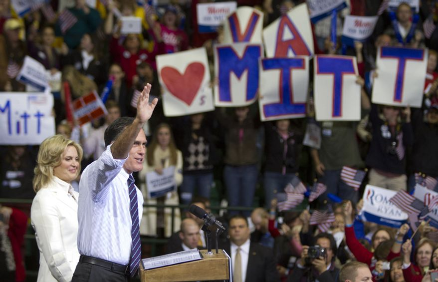 Republican presidential candidate, former Massachusetts Gov. Mitt Romney, accompanied by wife Ann, waves after speaking at a campaign event at George Mason University, Monday, Nov. 5, 2012, in Fairfax, Va. (Craig Bisacre/The Washington Times)