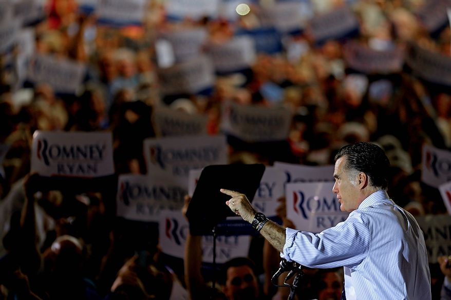 Republican presidential candidate Mitt Romney gestures as he speaks during a campaign event at the Orlando Sanford International Airport on Monday, Nov. 5, 2012, in Sanford, Fla. (AP Photo/David Goldman)