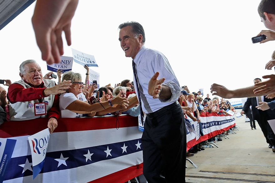 Republican presidential candidate Mitt Romney gestures as he greets supporters as he arrives at a campaign rally at Orlando Sanford International Airport in Sanford, Fla., on Monday, Nov. 5, 2012. (AP Photo/Charles Dharapak)