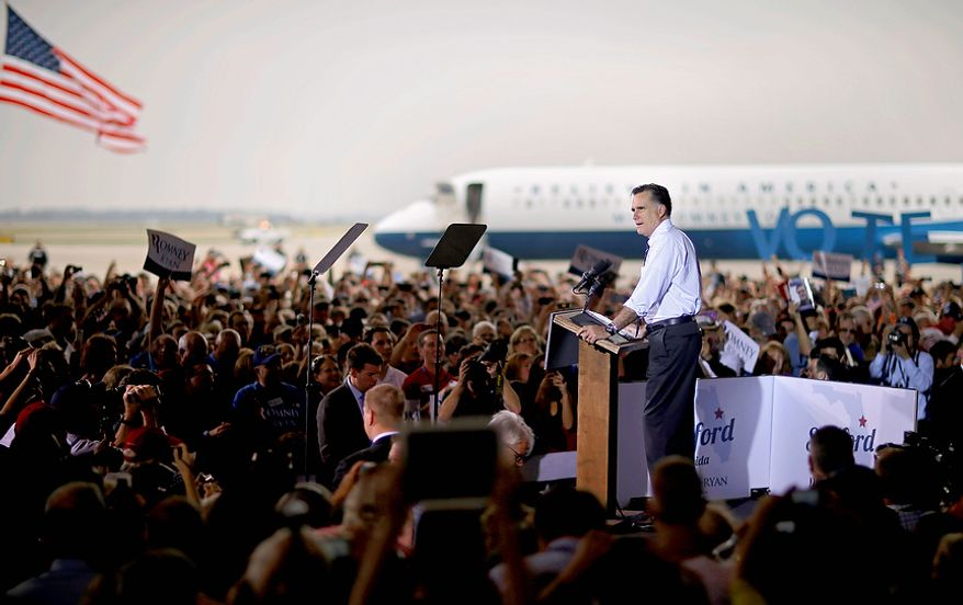Republican presidential candidate Mitt Romney speaks during a campaign event at Orlando Sanford International Airport on Monday, Nov. 5, 2012, in Sanford, Fla. (AP Photo/David Goldman)