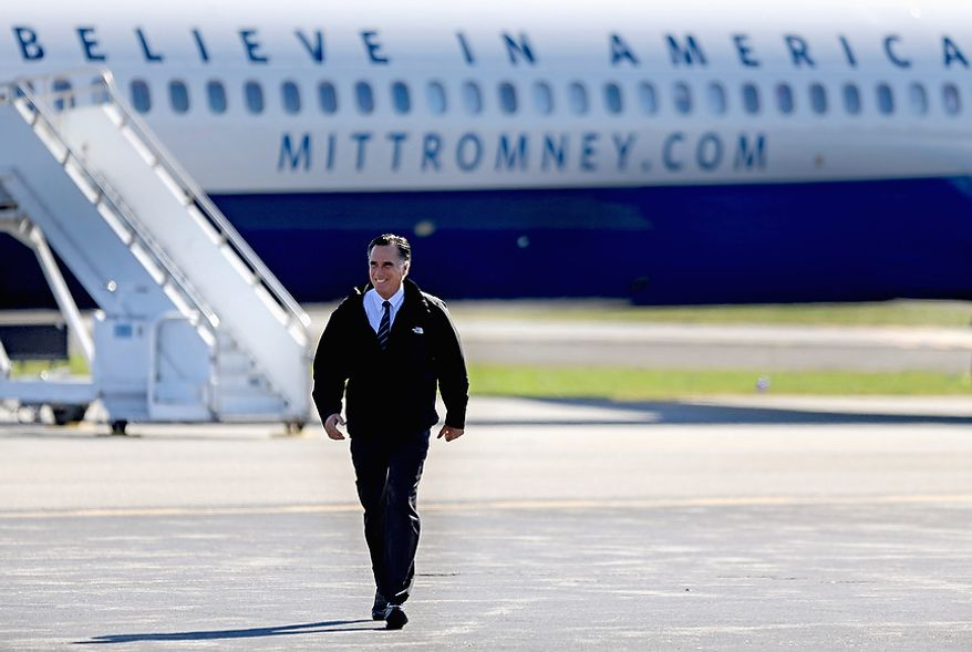 Republican presidential candidate, former Massachusetts Gov. Mitt Romney walks on the tarmac from his plane to speak at a campaign event at the Lynchburg Regional Airport, Monday, Nov. 5, 2012, in Lynchburg, Va. (AP Photo/David Goldman)