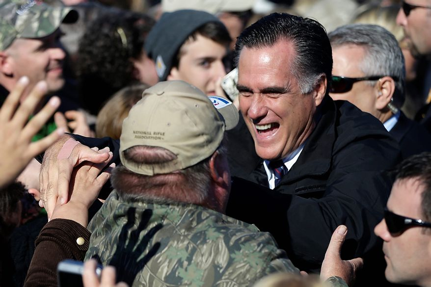 Republican presidential candidate, former Massachusetts Gov. Mitt Romney greets supporters at a Virginia campaign rally at Lynchburg Regional Airport, in Lynchburg, Va., Monday, Nov. 5, 2012. (AP Photo/Charles Dharapak)