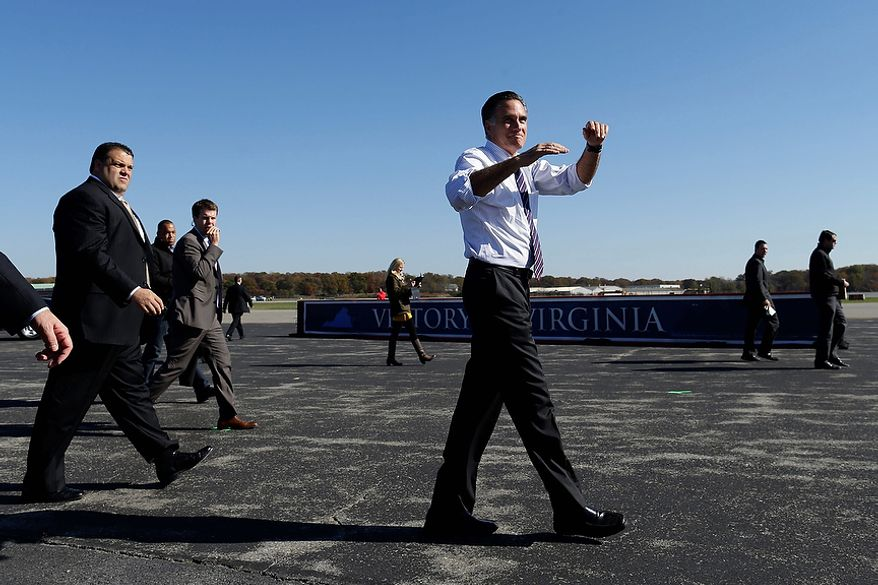 Republican presidential candidate, former Massachusetts Gov. Mitt Romney gestures as he leaves a Virginia campaign rally at Lynchburg Regional Airport, in Lynchburg, Va., Monday, Nov. 5, 2012. (AP Photo/Charles Dharapak)