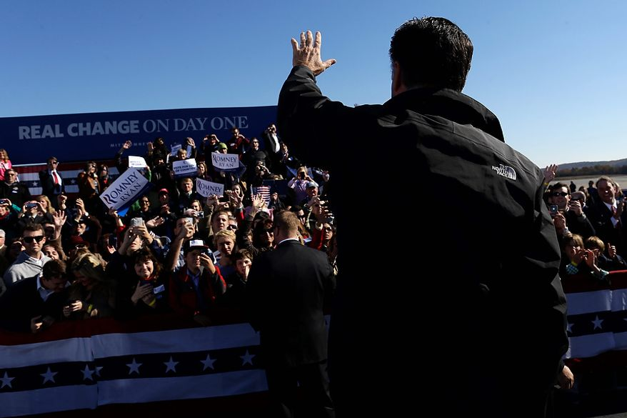 Republican presidential candidate, former Massachusetts Gov. Mitt Romney waves  to suppoters at a Virginia campaign rally at Lynchburg Regional Airport, in Lynchburg, Va., Monday, Nov. 5, 2012. (AP Photo/Charles Dharapak)
