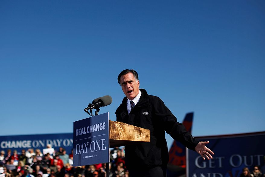 Republican presidential candidate, former Massachusetts Gov. Mitt Romney gestures as he speaks at a Virginia campaign rally at Lynchburg Regional Airport, in Lynchburg, Va., Monday, Nov. 5, 2012. (AP Photo/Charles Dharapak)