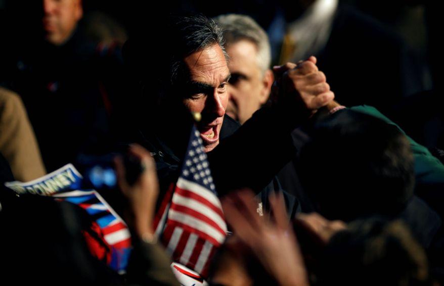 Republican presidential candidate Mitt Romney greets supporters at a campaign event at the Newport News/Williamsburg International Airport on Sunday, Nov. 4, 2012, in Newport News, Va. (AP Photo/David Goldman)
