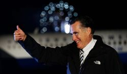 Republican presidential candidate Mitt Romney gives a thumbs up at the end of a campaign rally at Newport News/Williamsburg International Airport in Newport News, Va., on Sunday, Nov. 4, 2012. (AP Photo/Charles Dharapak)