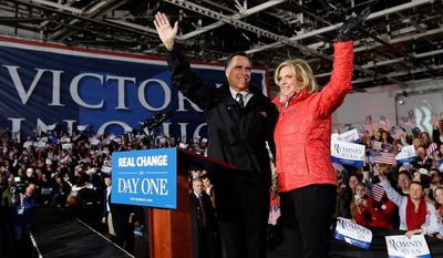 Republican presidential candidate and former Massachusetts Gov. Mitt Romney and Ann Romney arrive at a Ohio campaign rally at Port Columbus International Airport, in Columbus, Ohio, Monday, Nov. 5, 2012. (AP Photo/Charles Dharapak)