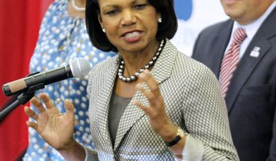 """Former Secretary of State Condoleezza Rice, center, gestures as she talks to Romney supporters at Broward College for a """"Get-Out-The-Vote"""" event as Florida Lt. Governor Jennifer Carroll, left, and Broward County Commissioner Chip LaMarca, right, look on in Davie, Fla., Monday, Nov. 5, 2012.Romney is making a strong push for Florida voters.(AP Photo/Alan Diaz)"""
