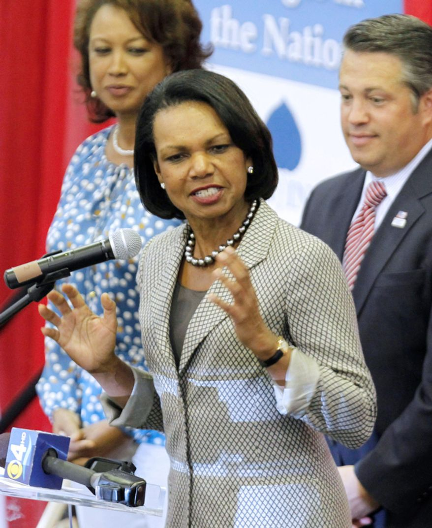 "Former Secretary of State Condoleezza Rice, center, gestures as she talks to Romney supporters at Broward College for a ""Get-Out-The-Vote"" event as Florida Lt. Governor Jennifer Carroll, left, and Broward County Commissioner Chip LaMarca, right, look on in Davie, Fla., Monday, Nov. 5, 2012.Romney is making a strong push for Florida voters.(AP Photo/Alan Diaz)"