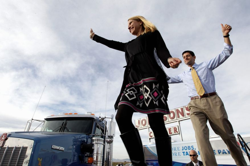 Republican vice presidential candidate, Rep. Paul Ryan, R-Wis., and his wife Janna arrive at a campaign event at Johnson's Corner, Monday, Nov. 5, 2012 in Johnstown, Colo.  (AP Photo/Mary Altaffer)