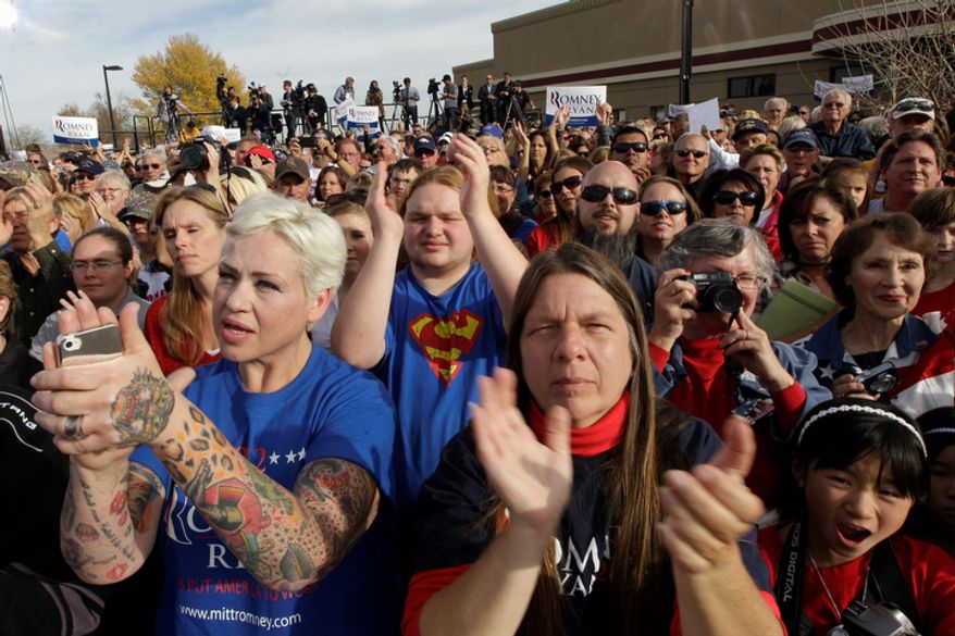 Supporters cheer as Republican vice presidential candidate, Rep. Paul Ryan, R-Wis., speaks during a campaign event at Johnson's Corner, Monday, Nov. 5, 2012, in Johnstown, Colo.  (AP Photo/Mary Altaffer)