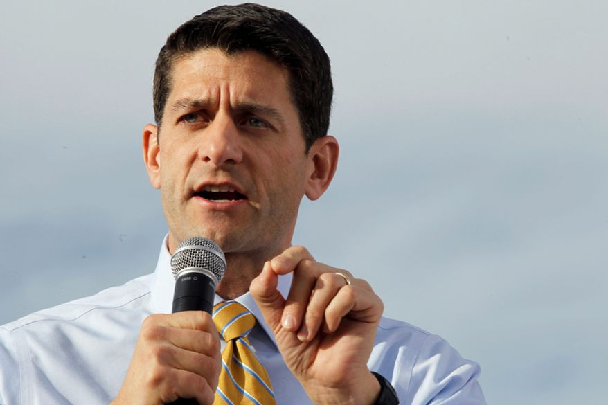 Republican vice presidential candidate, Rep. Paul Ryan, R-Wis., gestures as he speaks during a campaign event at Johnson's Corner, Monday, Nov. 5, 2012 in Johnstown, Colo.  (AP Photo/Mary Altaffer)