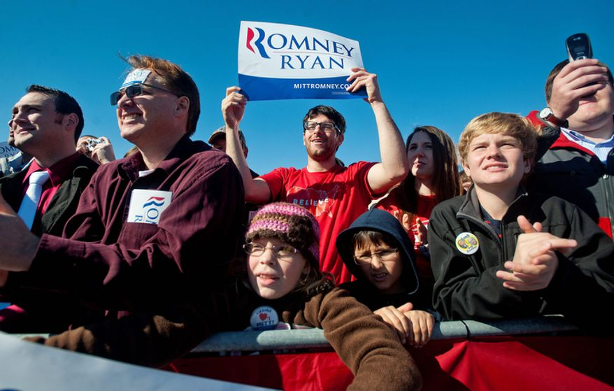 Supporters cheer for Republican presidential candidate, former Massachusetts Gov. Mitt Romney speaks to supporters at a Virginia campaign rally at Lynchburg Regional Airport in Lynchburg, Va., on Monday, Nov. 5, 2012. (AP Photo/News & Daily Advance, Jill Nance)