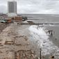 ** FILE ** Foundations and pilings are all that remain of brick buildings and a boardwalk in Atlantic City, N.J., on Tuesday, Oct. 30, 2012, after they were destroyed when a powerful storm that started out as Hurricane Sandy made landfall on the East Coast on Monday night. (AP Photo/Seth Wenig)
