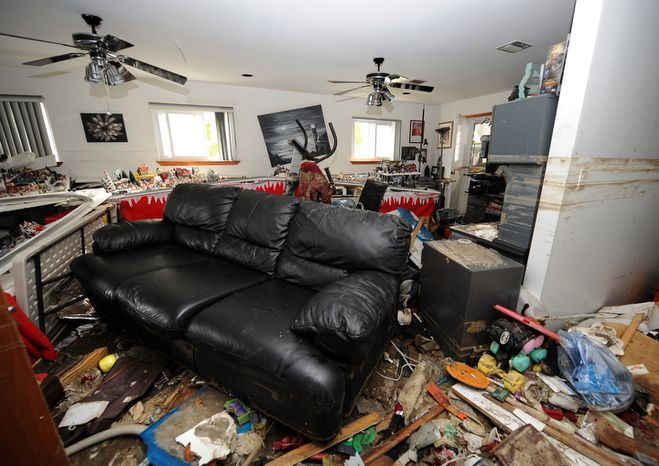 Debris covers the lower floor of Don Durando's house in Long Beach, N.Y. on Thursday, Nov. 1, 2012, after sustaining flooding and other damage from superstorm Sandy. Three days after Sandy slammed the mid-Atlantic and the Northeast, New York and New Jersey struggled to
