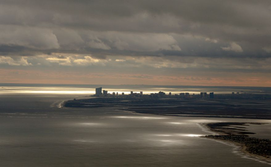 The Atlantic City, N.J., skyline is shown during a flight to document coastal changes by the National Oceanic and Atmospheric Administration after Superstorm Sandy on Thursday, Nov. 1, 2012. (AP Photo/Alex Brandon)