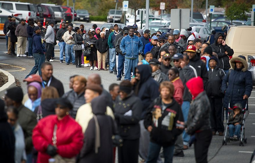 Hundreds of people wait in line for early voting at the Prince George's Sports & Learning Complex in Landover, Md., on Wednesday, Oct. 31, 2012. (Rod Lamkey Jr./The Washington Times)
