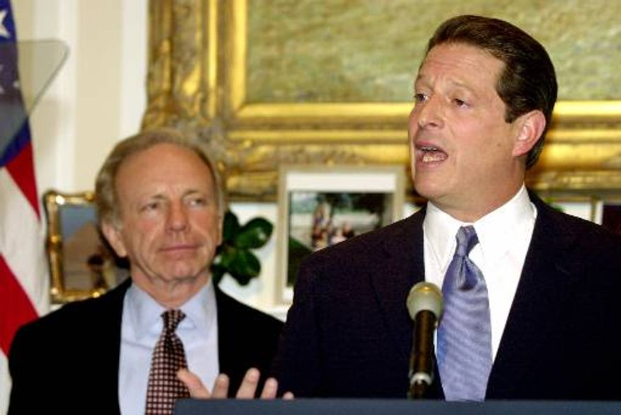 Vice President Al Gore (right), the Democratic presidential candidate, stands with his running mate, Sen. Joseph I. Lieberman, as he makes a statement from his home in Washington on Wednesday, Nov. 15, 2000, regarding the Florida recount controversy. (AP Photo/Susan Walsh)