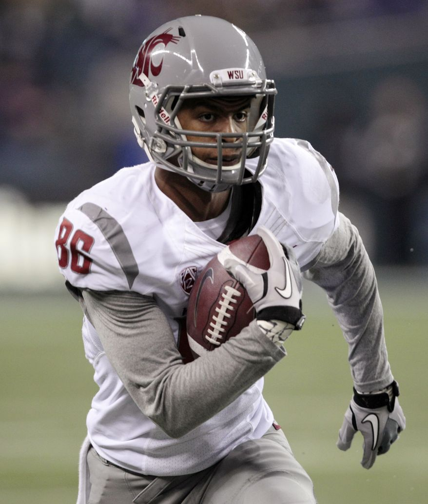 FILE - This Nov. 26, 2011 file photo shows Washington State's Marquess Wilson returning a reception for a 38-yard touchdown during the second half of an NCAA college football game against Washington, in Seattle. Washington State has suspended star receiver Wilson for an unspecified violation of team rules. Team spokesman Bill Stevens could not say Monday, Nov. 5, 2012 how long the suspension would last or specifics about why Wilson was punished by first-year coach Mike Leach.(AP Photo/Elaine Thompson, File)