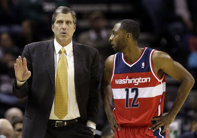 Washington Wizards' A.J. Price (12) talks with head coach Randy Wittman, left, during the first quarter of an preseason NBA basketball game against the San Antonio Spurs, Friday, Oct. 26, 2012, in San Antonio. (AP Photo/Eric Gay)