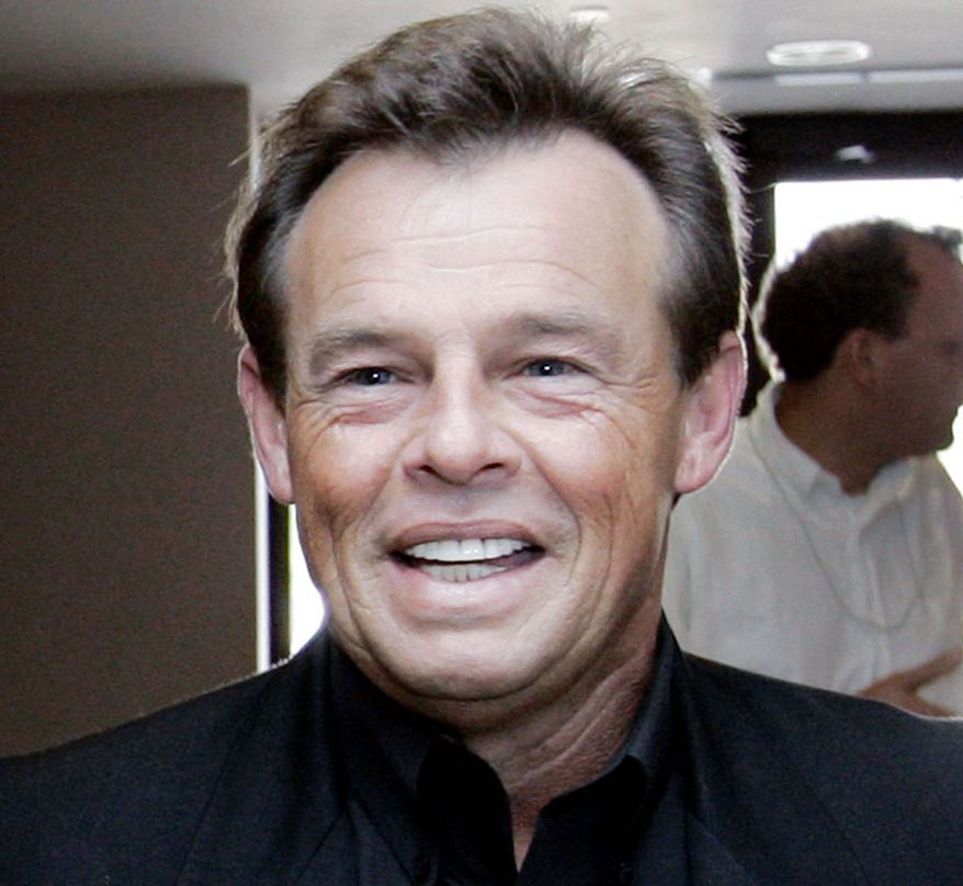 Country singer Sammy Kershaw and others on his tour bus survived a collision on Friday in Texas. They were shaken and sore but not seriously hurt. (Associated Press)