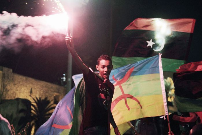 Libyans celebrate one year on since the country was declared liberated from former dictator Moammar Gadhafi, at Martyrs Square in Tripoli, Libya , Tuesday, Oct. 23, 2012. (AP Photo/Gaia Anderson)
