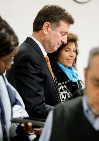 George Allen, the GOP candidate for Senate in Virginia, and his wife, Susan, wait to vote in Fairfax. (Eva Russo/Special to the Washington Times)