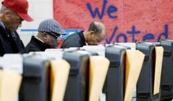 Voters cast their ballots in the general election at the polls set up at Ridgecrest Elementary School, in Hyattsville, on Nov. 6, 2012. (Associated Press)