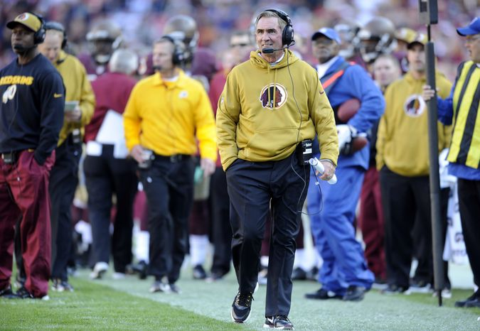 Washington Redskins head coach Mike Shanahan walks on the sidelines during the first half of an NFL football game against the Carolina Panthers Sunday, Nov. 4, 2012, in Landover, Md. (AP Photo/Nick Wass)