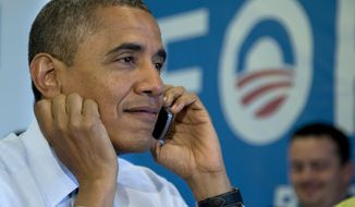 President Obama calls Wisconsin volunteers while visiting a campaign office call center in Chicago on Nov. 6, 2012, the morning of the 2012 election. (Associated Press)