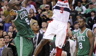 Washington Wizards forward Martell Webster (9) takes a shot against Boston Celtics forward Kevin Garnett (5) during the second half of an NBA basketball game, Saturday, Nov. 3, 2012, in Washington. The Celtics won 89-86. (AP Photo/Nick Wass)